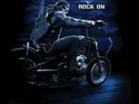 Рокер с гитарой на мотоцикле